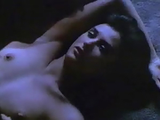 Brunette: lovely actress Demi Moore lying topless on a bed
